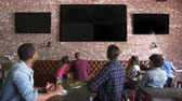 forties : Friends Watching Game In Sports Bar On Screens Shot On R3D