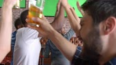ponto : Friends Watching Game In Sports Bar Shot In Slow Motion