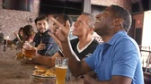 forties : Group Of Male Friends Watching Game In Sports Bar