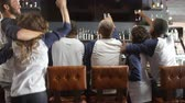 matches : Rear View Of Friends Watching Game In Sports Bar Celebrating Stock Footage