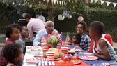 vnuk : Multi generation black family talking at 4th July barbecue