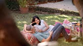 vinho : Mature Couple Relax In Garden Together Shot In Slow Motion Vídeos
