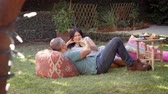forties : Mature Couple Relax In Garden Together Shot In Slow Motion Stock Footage
