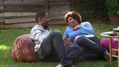 dva lidé : Mature Couple Relax In Garden Together Shot On R3D