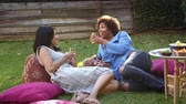 forties : Mature Female Friends Relax In Garden Together Shot On R3D