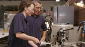 internovat : Engineer Training Female Apprentice On Lathe Shot On R3D Dostupné videozáznamy