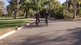 bisikletçi : Senior Couple Cycling Through Park In Slow Motion