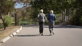 lifestyle shot : Rear View Of Senior Couple Exercising With Run Through Park