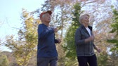 lifestyle shot : Senior Couple Exercising With Run Through Park Stock Footage