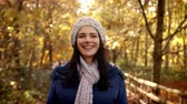 scarf : Portrait Of Attractive Woman On Walk In Autumn Countryside Stock Footage