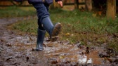 tendo : Close Up Of Girl Splashing In Puddle Shot In Slow Motion Vídeos