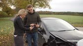 road : Two Drivers Exchanging Insurance Details After Car Accident Stock Footage
