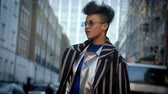 social media : Stylish Fashion Blogger Standing In Urban Street Stock Footage