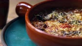 patlıcan : Aubergine, feta and tomato bake in earthenware dish, zoom Stok Video