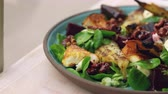 перец чили : Baked goats cheese and pear salad by a window, close up pan