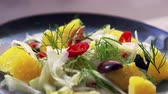 перец чили : Shaved fennel and orange salad on plate, close up pan Стоковые видеозаписи