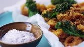pan left : Fried squid with kale and sumac mayo, extreme close up, pan Stock Footage