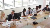 nativo : Group Of Businesspeople Meeting Around Table In Boardroom Vídeos