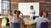 attention : Young black woman giving presentation to business colleagues Stock Footage