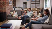 flooring : Family Sit On Sofa In Open Plan Lounge Watching Television Stock Footage