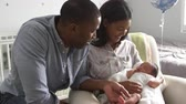 orgulho : Parents Home from Hospital With Newborn Baby In Nursery Stock Footage