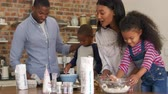 four children : Parents And Children Baking Cakes In Kitchen Together Stock Footage