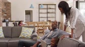 flooring : Father And Son Sit On Sofa In Lounge Using Digital Tablet Stock Footage