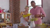 más : Mixed race couple making smoothies together at home, shot on R3D