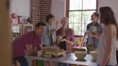 exposto : Five friends laughing over coffee in kitchen, shot on R3D