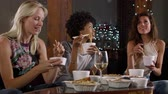 Çin yemek çubukları : Three female friends talking and eating a Chinese take-away, shot on R3D