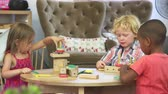foco no primeiro plano : Montessori School Pupils Work At Desk With Wooden Building Set Stock Footage