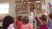ask : Pupils At Montessori School Raising Hands To Answer Question Stock Footage