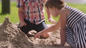 jardim de infância : Pupils At Montessori School Playing In Sand Pit At Breaktime Stock Footage