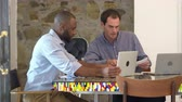 muro de pedras : Two men working together at computer in boardroom, slow motion