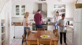 four people : Family With Teenage Children Preparing Breakfast In Kitchen