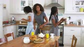 limpeza : Daughters Helping Mother To Clear Table After Family Breakfast