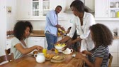 kruvasan : Family With Teenage Children Eating Breakfast In Kitchen
