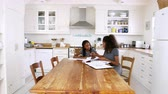lição de casa : Two Sisters Sitting At Table In Kitchen Doing Homework Vídeos
