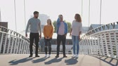 zenci amerikalı : Group Of Young Friends Standing On City Bridge Together