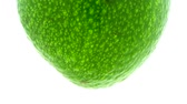 diet : Green avocado rotates in loop at white background