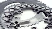 Silver oval bicycle chainring gear rotating at white background Dostupné videozáznamy