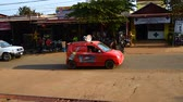 Камбоджа : Local small Cambodia beer car carries loudspeakers on the Banlung district. March 3, 2018, Cambodia. Banlung town.