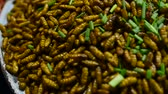 Cambodian night street food with dried and grilled larvae, close up with sharp details of worms. Dostupné videozáznamy