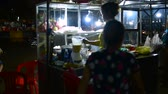 cambojano : Night street food market, two womans preparing food for customers. 05 march 2018 Banlung town, Cambodia.