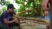 kamboçyalı : Cambodian man prepares wood to build a traditional construction using handsaw. He incise wooden beam to fit with other wooden beam. 28 november 2017, Koh Rong Samloem. Cambodia.