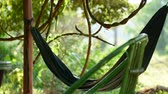hamak : Green hammock flutters in the wind with the jungle in the background during daytime. Koh Rong Samloem island, Cambodia.