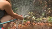 hosepipe : Woman cleaning her hands in the middle of the jungle