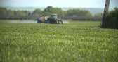 pesticide : Tractor spray fertilize on field with chemicals in agriculture field. Stock Footage