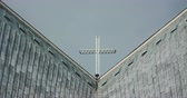 simbolismo : Cross On Top Of Church Against Clear Sky Stock Footage