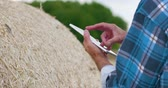 fertilizer field : Modern Farmer Using Digital Tablet